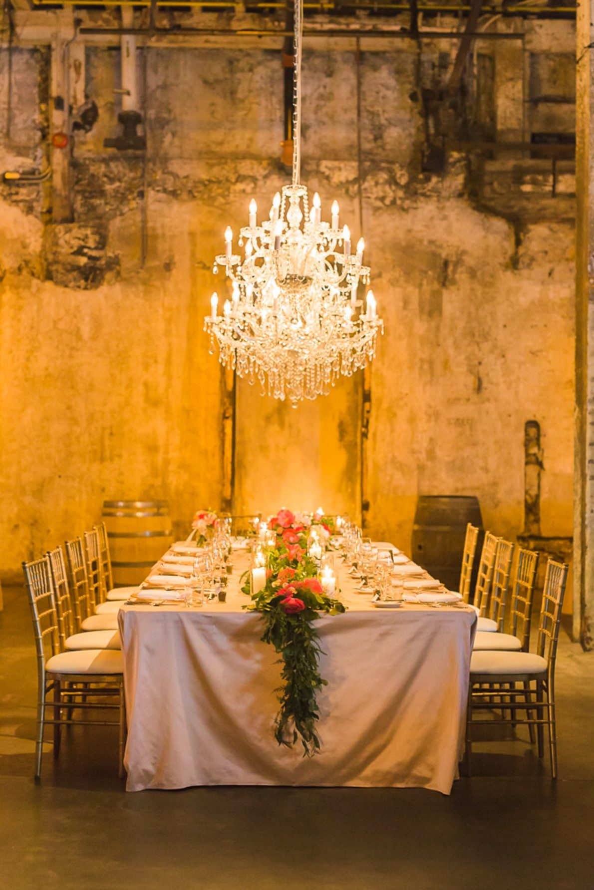 Wedding Decor and Chandelier Distillery District Fermenting Cellar Candle Lit Toronto Wedding Photography