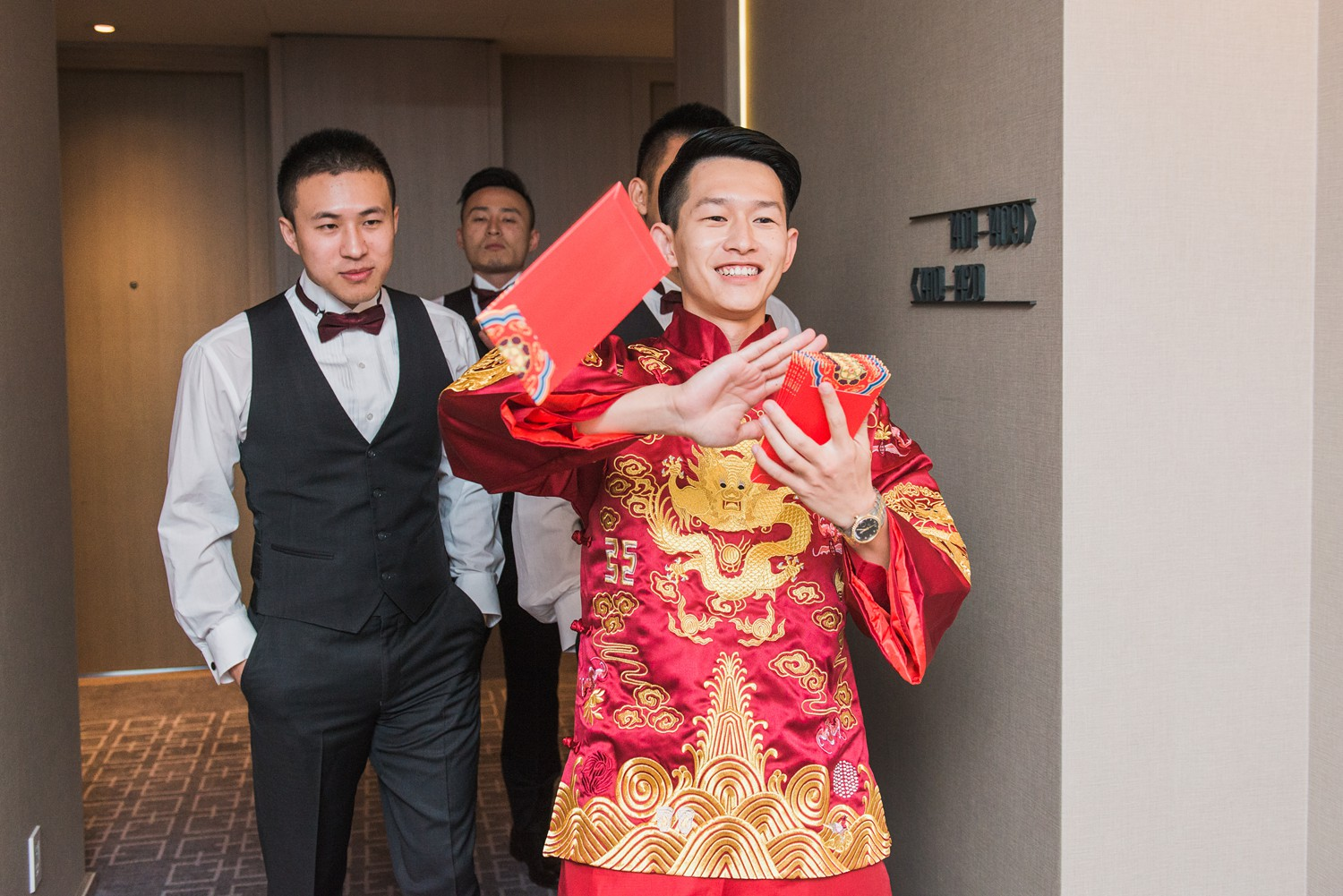 Red Pockets Chinese Tea Ceremony Luxury Yorkville Vinci Toronto Four Season Wedding Photos with Chinese Bride and Groom