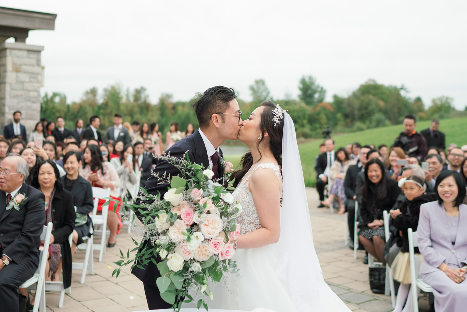 First_Kiss_Eagles_Nest_Golf_Club_Wedding_Photos_Toronto_Wedding_Photographer-Rhythm_Photography