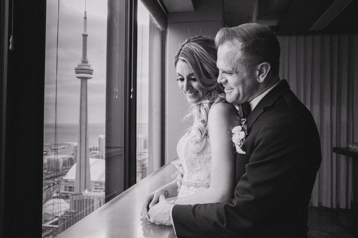 CN Tower Bride and Groom Photoshoot Downtown Financial District Winter Canoe Restaurant Toronto Wedding Photos-Rhythm_Photography