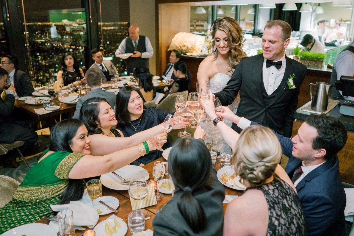 Table Toasting Downtown Financial District Winter Canoe Restaurant Toronto Wedding Photos-Rhythm_Photography