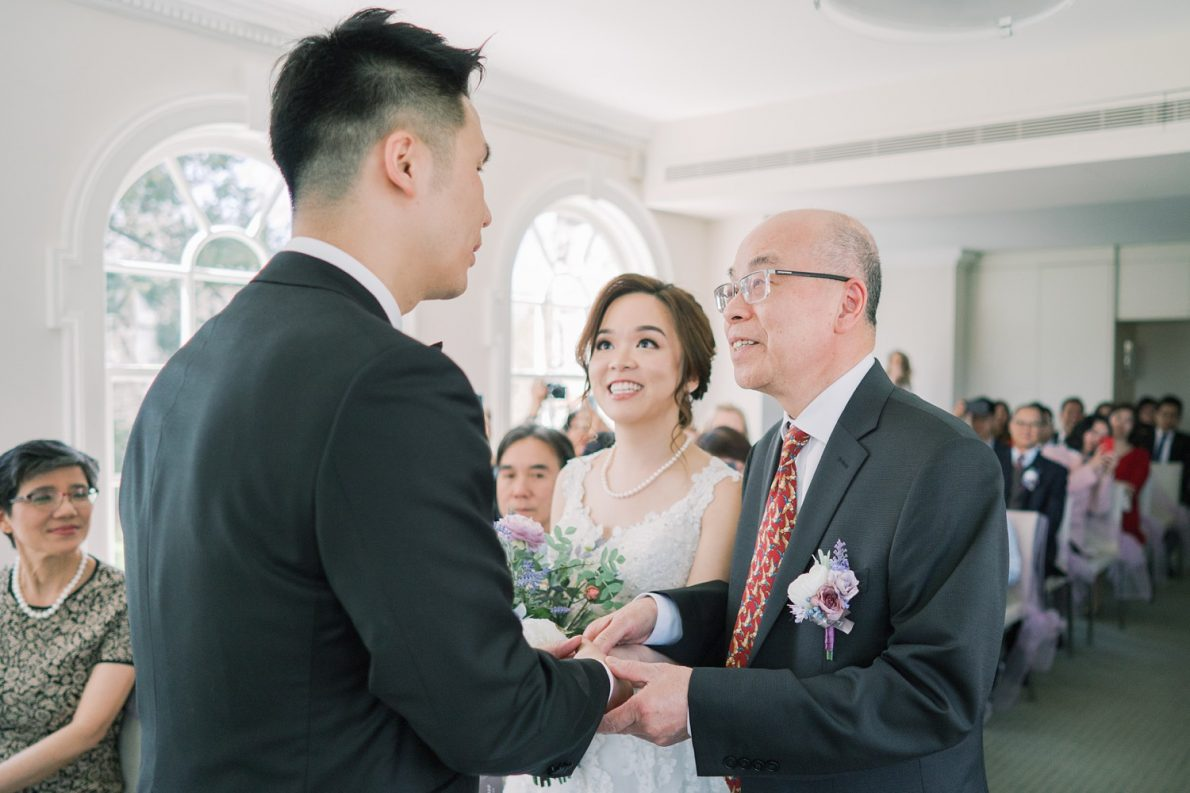 Walking down the aisle in Bayview Room at Estates of Sunnybrook McLean House Toronto Wedding Photos