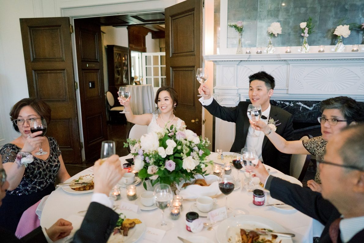 table toasting at Lunch reception in Estates of Sunnybrook McLean House Toronto Wedding Photos
