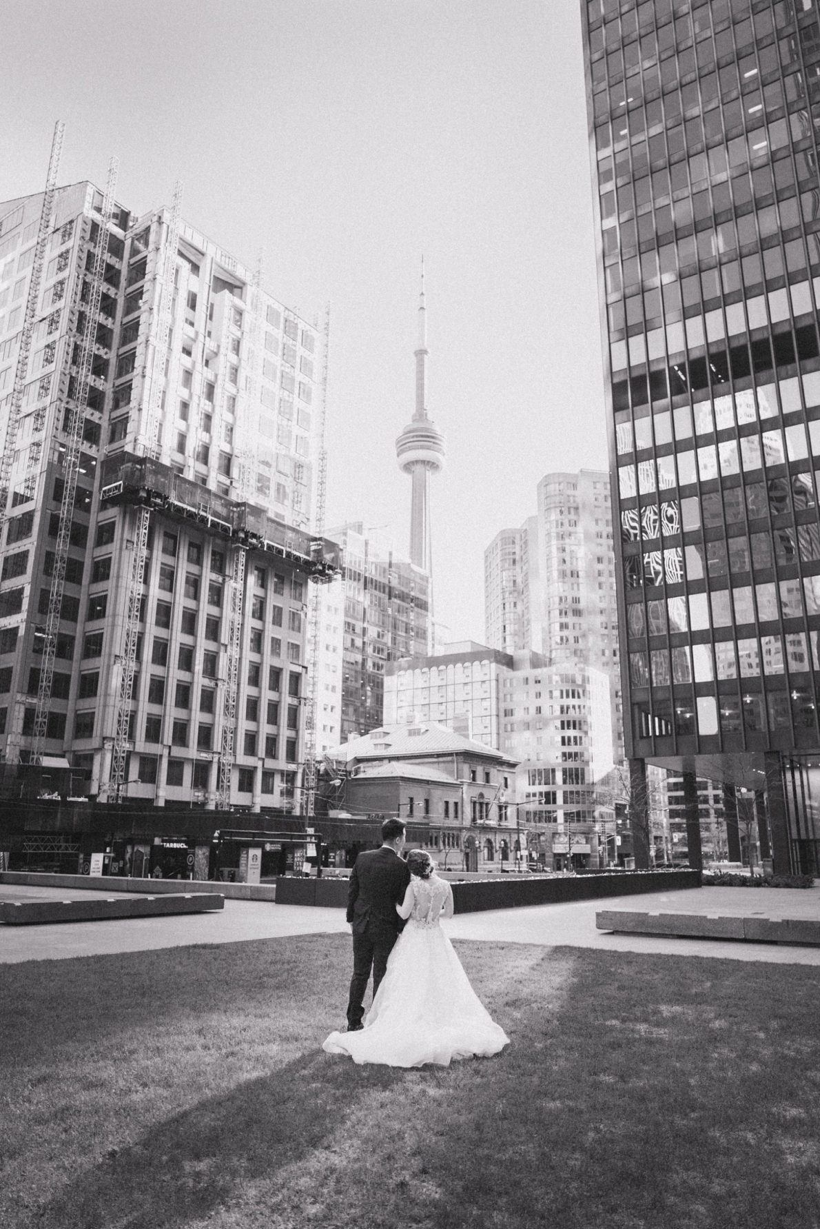 CN Tower Sunset Bride and groom outdoor portraits in Downtown Toronto Financial District Toronto Wedding Photos