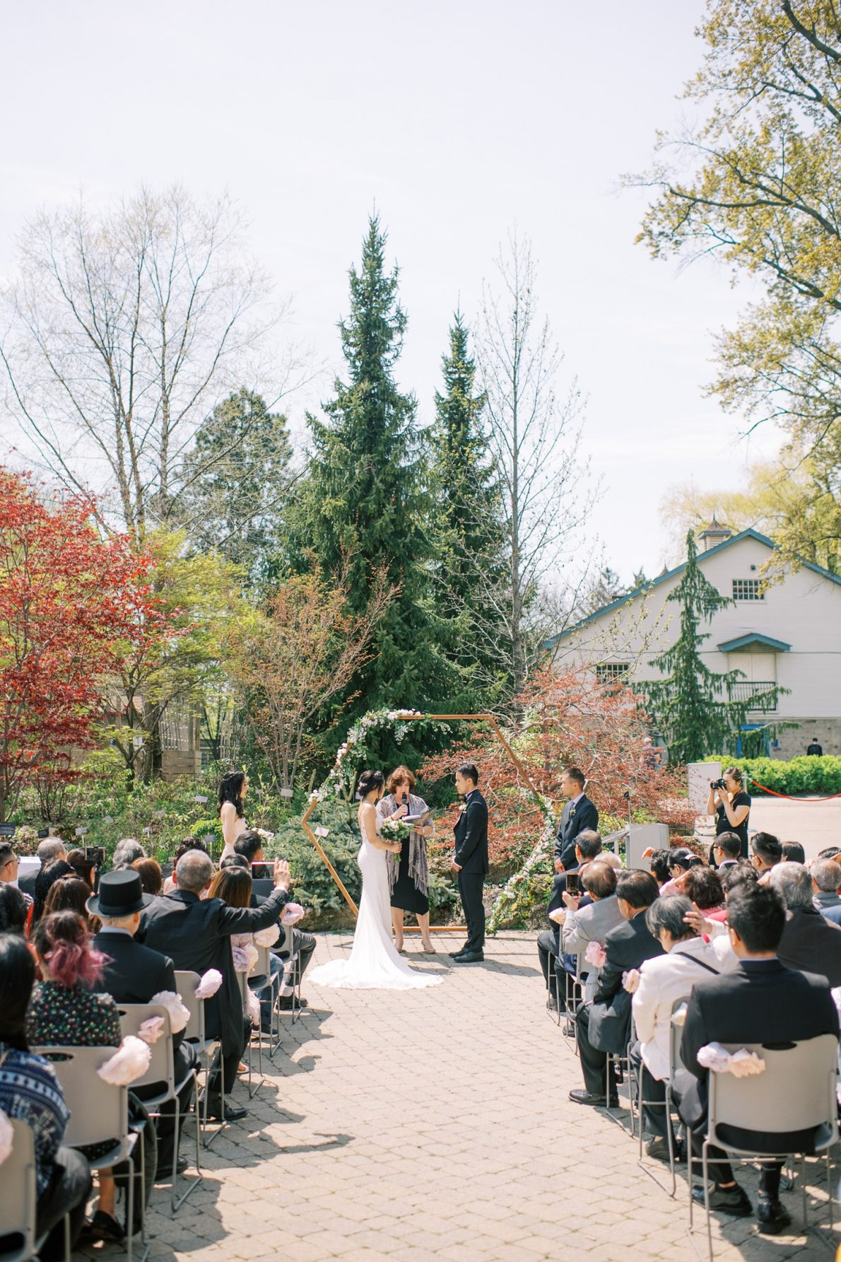 Outdoor wedding ceremony at Edwards Garden and Toronto Botanical Garden Wedding Photos